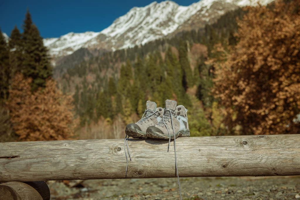 boots on a background of mountains